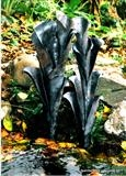 Arum Lily water feature by Spencer Field Larcombe, Metal, Hot forged mild steel