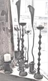 Assortment of candlesticks by ARTIST BLACKSMITH, Metal